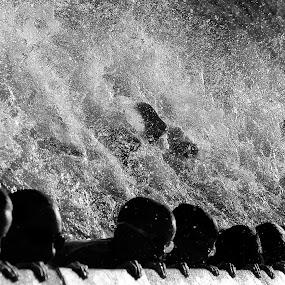 Making a Splash by Bill Morris - Black & White Portraits & People ( water, kicking, children, feet, kids )