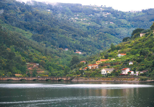 Uniworld-Queen-Isabel-Douro-River - Guests will marvel at majestic scenery as Uniworld's Queen Isabel makes her journey along the serene Douro River Valley in Portugal and Spain.