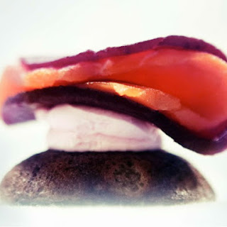 Black Olive Mini Blinis with Pink Mascarpone, Salmon, and Preserved Beet