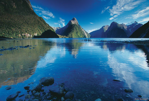 Milford_Sound_in_summer - Mitre Peak takes centre stage in this perfect view of Milford Sound in summer.  Carved by glaciers over thousands of years, Fiordland is a world of deep waters, tall peaks and waterfalls.