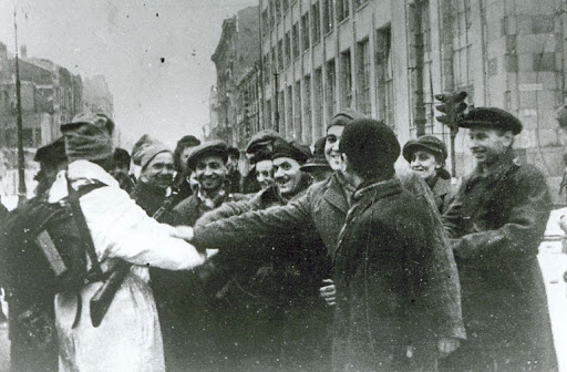 Warsaw citizens greet their liberators — soldiers of the Red Army and First Polish Army, 17 January 1945