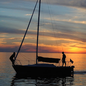 End of the day of sailing by Heather Donahue - Transportation Boats