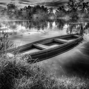 Old flatboat by Alan Grubelić - Black & White Landscapes ( winter, b&w, reflections, lake, boat )