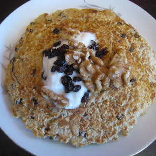 Black Currant Oatmeal Pancakes with Walnuts and Organic Yogurt.