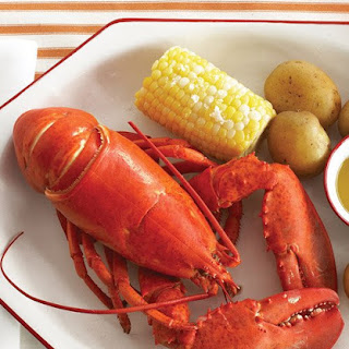 Boiled Lobsters with Corn and Potatoes.
