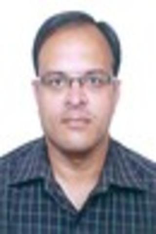 Dr. Hiren Dholakia