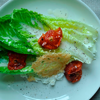 Goat Cheese Caesar Salad with Roasted Tomatoes and Parmesan Crisp.