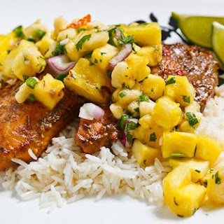 Jerk Fish on Coconut Rice Topped with Banana and Pineapple Salsa.