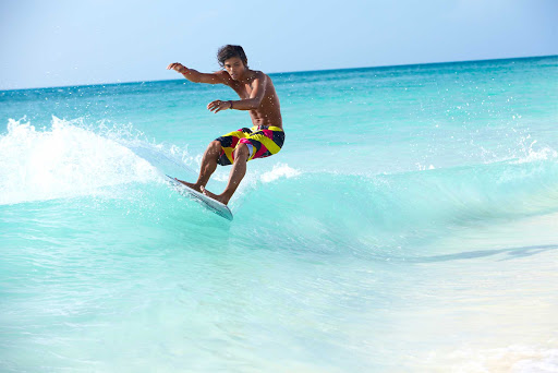 waveboard-Aruba - A dude shows perfect form while wave boarding on Aruba. It's a type of small surfboard.