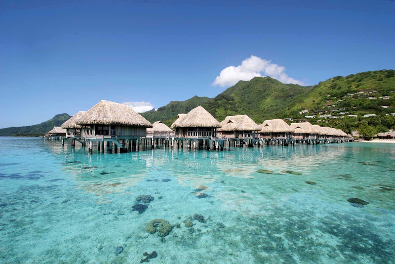 Overwater bungalows line the reef and beach at Sofitel Ia Ora on Mo'orea.