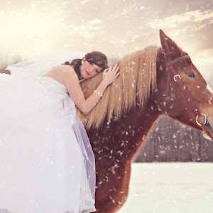 kelcie on horse toned with snow.jpg