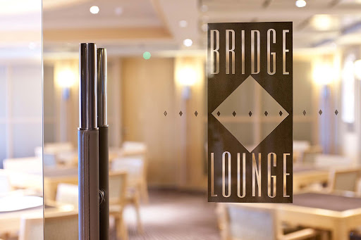 Enrichment-Entertainment-Bridge-Lounge-on-Crystal-Symphony - The chic Bridge Lounge on the Crystal Symphony is the perfect place to play cards or relax with a mimosa.