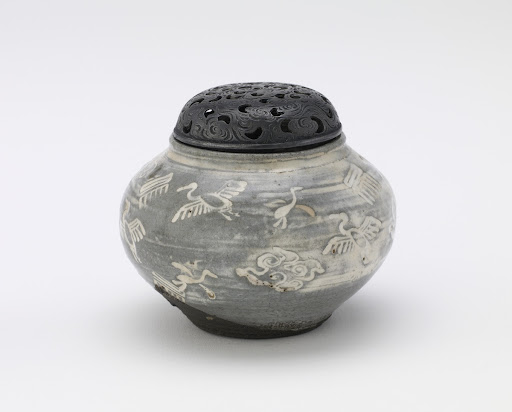 Small incense burner with slip-inlaid stamped decor