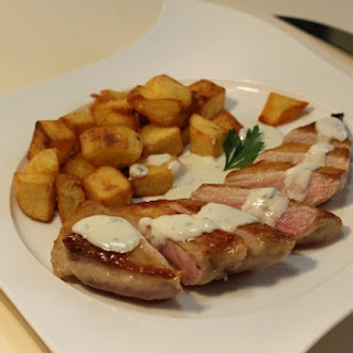 """""""Secreto Iberico"""" with Tresviso Cheese Sauce and Perfect Fries."""