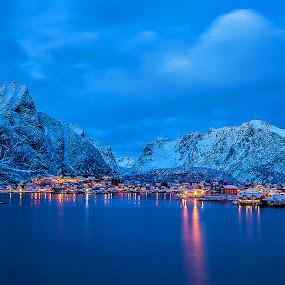 reine twilight II by Ennio Pozzetti - City,  Street & Park  Vistas ( water, lights, mountains, pano, reine, blue, blue hour, snow, city lights, seascape, lofoten, norway,  )
