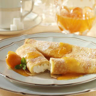 Luscious Cheese Crepes With Apricot Sauce.