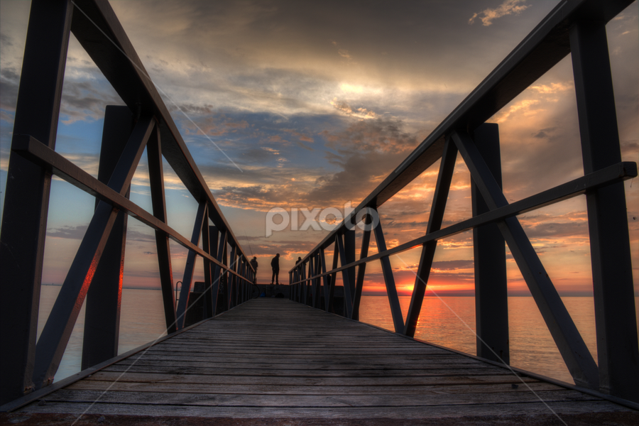 Fishing by Julija Moroza Broberg - Buildings & Architecture Bridges & Suspended Structures ( skyline, person, clouds and sea, jetty, coastline, people, guys, coast, sky, path, pier, pink, men, evening, clouds, pathway, hobby, sea, seascape, shadows, fishermen, frame, wooden, season, sunset, night, bridge, fishing, low )