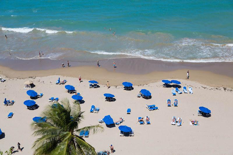 Visitors flock to Isla Verde Beach in Puerto Rico.