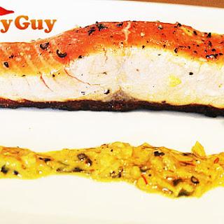 Pan Seared Salmon With A Creamy Saffron Sauce.