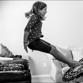 Bounce! by Nicole Mitchell - Black & White Portraits & People ( couch, girl, fly, fun, bounce )