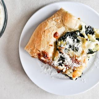Cheesy Spinach and Artichoke Pizza.