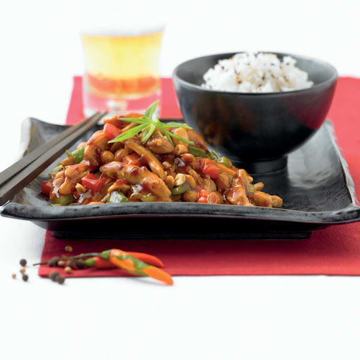 Silk Kung Pao Chicken - Silk Harvest's kung pao chicken served with a hint of chili and steamed rice on your Celebrity cruise.