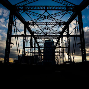 Into the Night by Luke Popwell - Buildings & Architecture Bridges & Suspended Structures ( clouds, water, nashvegas, city by the river, art, tennessee, walking bridge, scenic, landscape, artwork, city scape, sky, sunset, nashville, outdoors, scenery, down town, river, waterway )