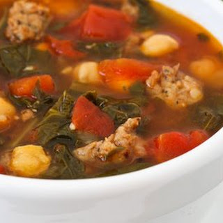 Sausage and Red Russian Kale Soup with Tomatoes, Chickpeas, and Herbs.