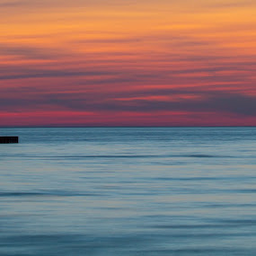 Serenity by Chip Ormsby - Landscapes Sunsets & Sunrises ( canon, water, michigan, orange, petosky, lake michigan, purple, blue, serenity, light house, lighthouse,  )