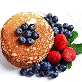 Pancakes stack by Vrinda Mahesh - Food & Drink Plated Food ( stacked, american food, pancakes close up, berries on top, breakfast, white background, plated food, morning, blueberries, kids breakfast, syrup, cakes, griddle, food macro, pancakes, square, berries )