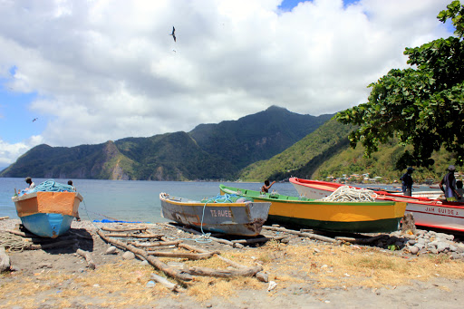 The picturesque town of Soufriere in Dominica - colorful boats and hot springs abound.