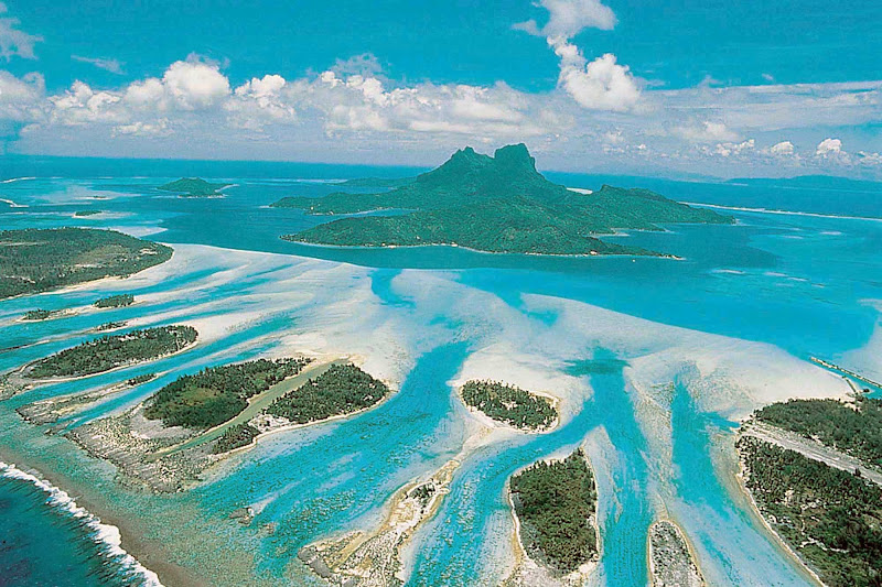 An aerial view of Bora Bora shows the miles of barrier reef surrounding the island.