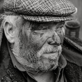 Middle-aged man by Elias Spiliotis - People Portraits of Men ( black and white, greece, tired, celebration, people, portrait, man,  )