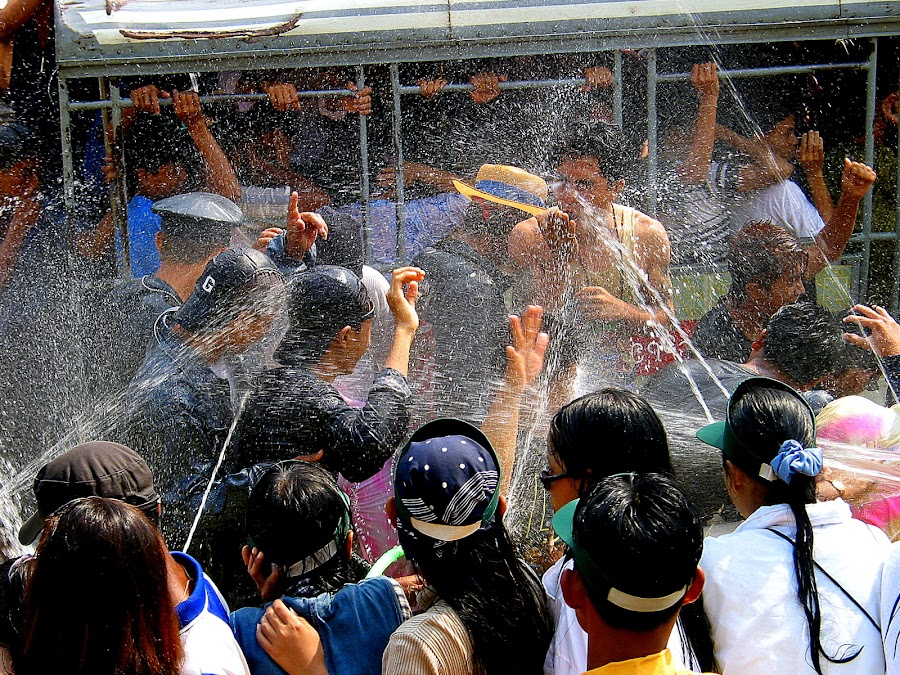 Showers of blessings by Leong Jeam Wong - People Street & Candids ( water, hose, spray, splashing, festival, wet, thingyan, fun, crowd, school children )