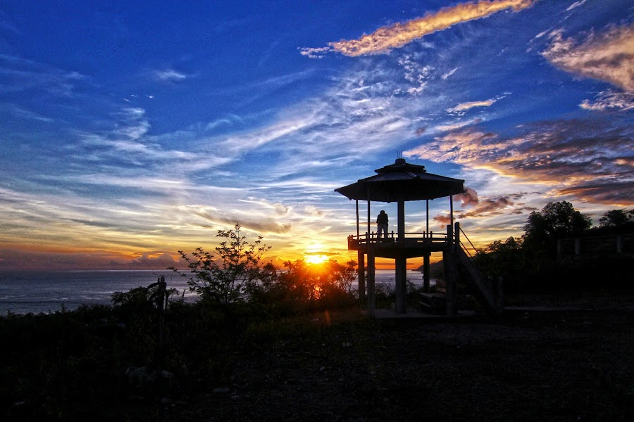a photographer was shooting the sunset by Roly Raseda - Landscapes Sunsets & Sunrises