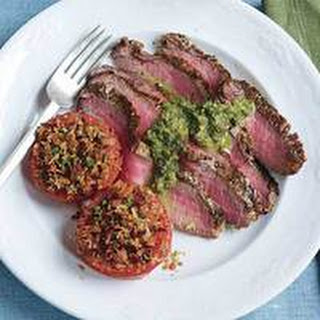 Sliced Steak with Parsley-Caper Sauce and Broiled Tomatoes with Bacon-Bit Breadcrumbs.
