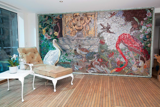 The handcrafted mosaic artwork is a luxurious feature of the S.S. Antoinette's indoor heated swimming pool.
