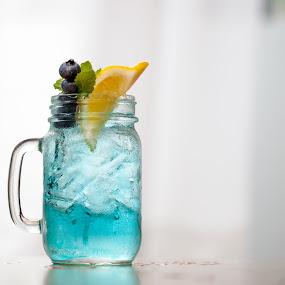 Blue Mason Jar - Off Center by Jim DeMicco - Food & Drink Alcohol & Drinks ( blue, drink, mason jar, blueberries, lemon )