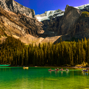 Moraine Lake by Joseph Law - Landscapes Waterscapes ( snoy, reflection, blue sky, rocky mountain, boats, trees, moraine lake )