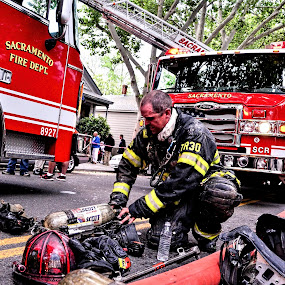 Firefighter readiness by Kati Garner - News & Events Disasters ( firefighter, facemask, firetruck, gloves, helmut, air tank )