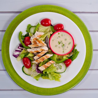 Tossed Green Salad With Chicken And Crushed Black Pepper.