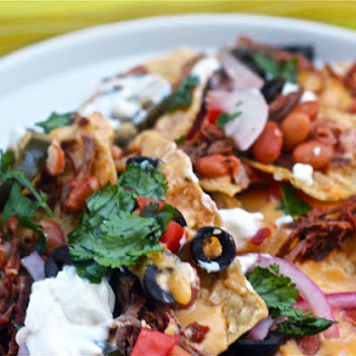 Beef Barbacoa Nachos with Pickled Red Onions