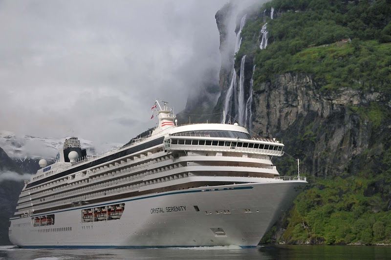 Crystal Serenity sails by lovely misty waterfalls in North Cape Geiranger, Norway.