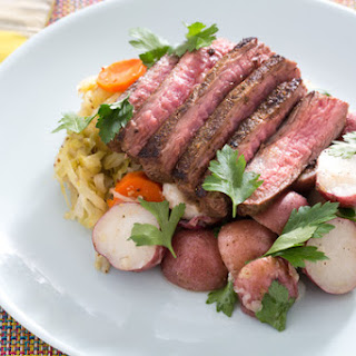Corned Beef-Spiced Flank Steaks with Braised Cabbage & Buttered Red Potatoes.