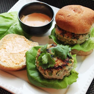 Skillet Chicken Burgers with Ginger, Scallions, and Sriracha Mayonnaise.