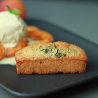 Hazelnut Basil Financiers with apricot Compote and vanilla ice cream.
