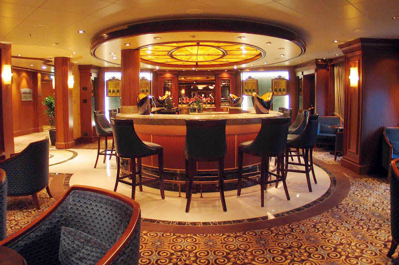 Sip champagne from flawless Waterford crystal flutes at the Veuve Clicquot Champagne Bar aboard Queen Mary 2.