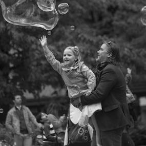 Catch the Bubble by Johannes Mikkelsen - Black & White Portraits & People ( black and white, art, white, bubbles, catch, children, tamron, people, portrait, norway, child, bubble, girl, d800, family, oslo, artistic, grey, soap, norge, bnw, nikon, black, KidsOfSummer )