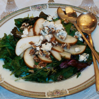 Caramelized Pear Salad with Toasted Walnuts on Mixed Young Greens.