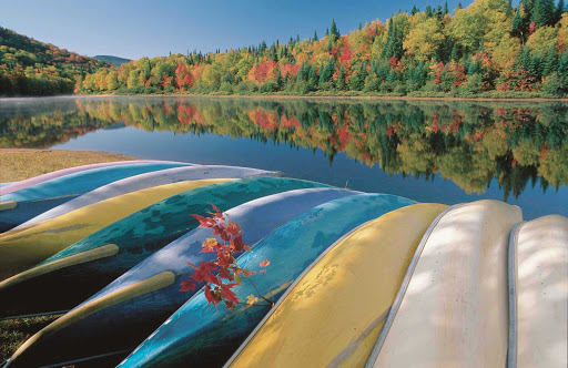fall-foliage-canoes-Quebec - Fall is a lovely time to travel by foot or canoe in Jacques-Cartier National Park, Quebec, Canada.
